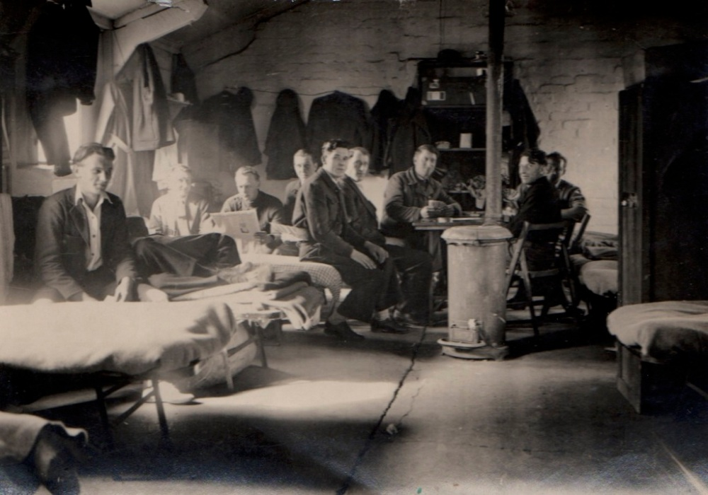 WWII prisoners-England-Robert to right of man with newspaper